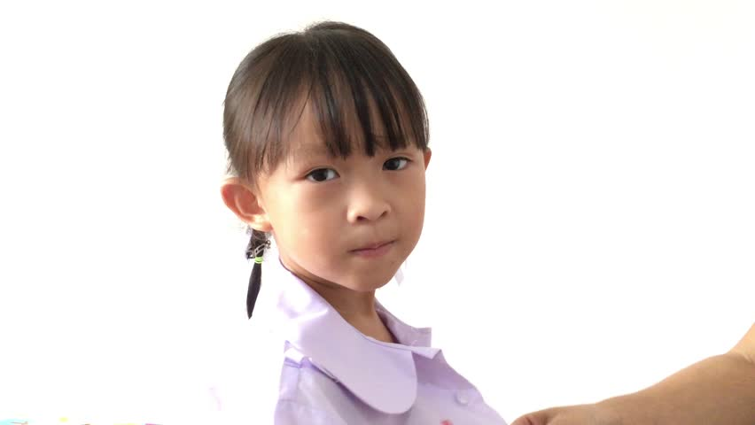 Serious cute little girl with ponytails and round for Tiny thai teen