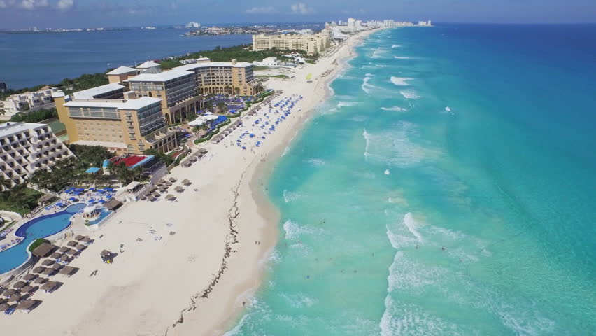 Overhead aerial view of the resorts and hotels along the beautiful white sand beaches and blue turquoise waters of the Caribbean ocean