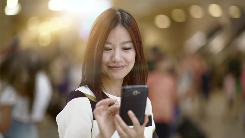 Young asian women standing in the city using smart phone texting friends. chinese female lifestyle portrait  | Shutterstock HD Video #16830178