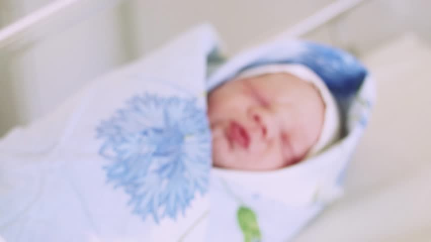 Nurse Put On White Disposable Diaper On Newborn Crying ...