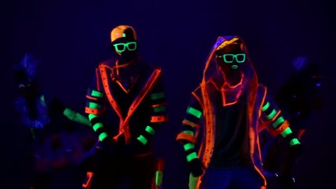 Dance group in neon costumes