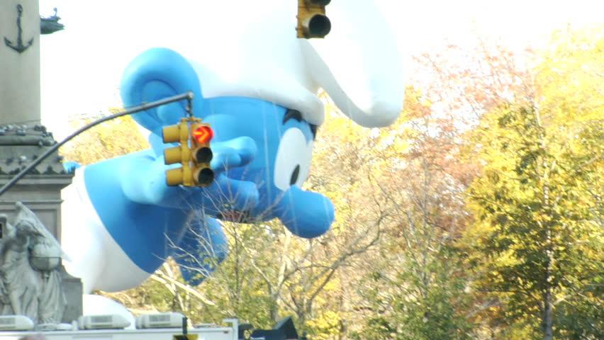NEW YORK - NOVEMBER 24: Smurf Balloon passes Columbus Circle at the Macy's Thanksgiving Day parade, November 24, 2011 in New York