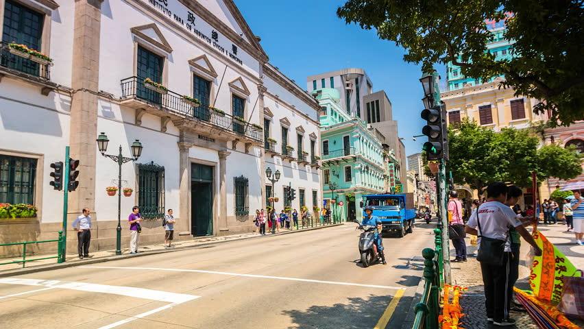 MACAU - CHINA - MAY 11: Time lapse People crossing the street area Macau city on 11 May 2016 in Macau, China  | Shutterstock HD Video #16940128