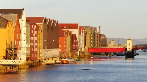 Sunset view of the Old Town pier architecture in Trondheim, Norway