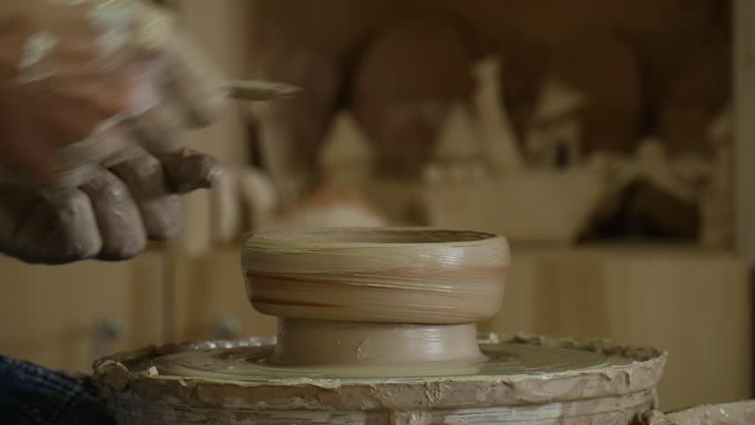 Potter Craftsman Is Working On Pottery Wheel Glazing A