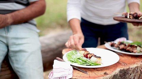 Entre Rios, Argentina - January 31, 2013: Serving freshly grilled kebabs