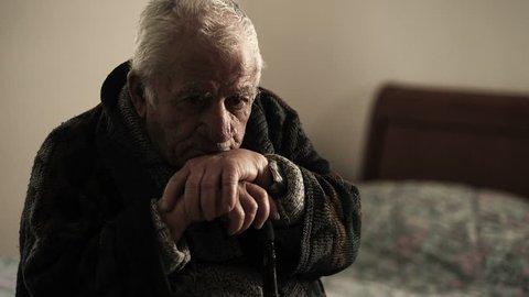 Detail of sick depressed old man in nurse home