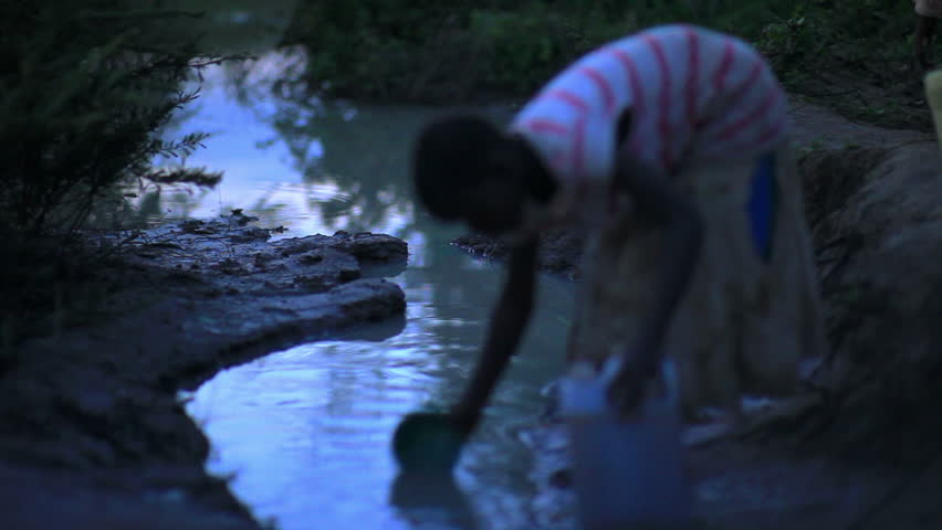 KENYA, AFRICA - CIRCA AUGUST 2010: Child gathering water near a village in Kenya
