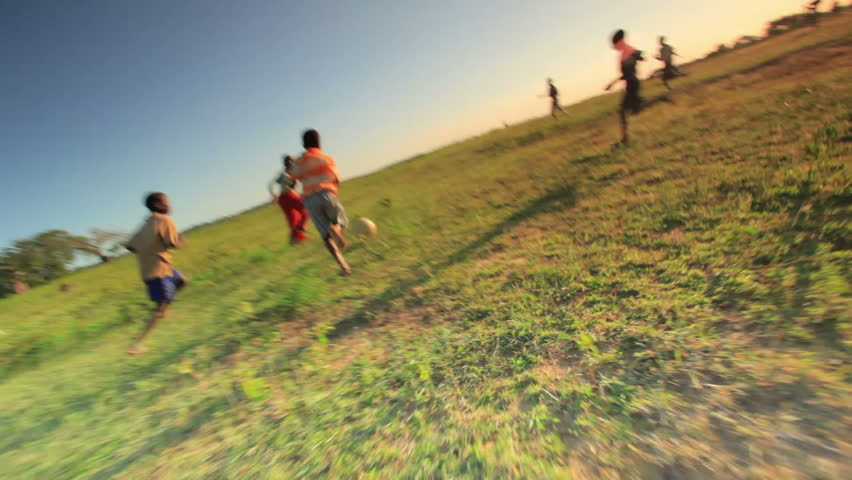 KENYA, AFRICA - CIRCA AUGUST 2010: Shot of children playing soccer on the fields in Kenya, Africa circa August 2010.