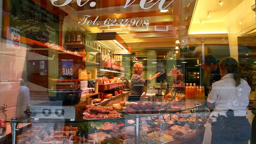 AMSTERDAM - CIRCA APR 2011: A delicatessen display window looks enticing circa April 2011 in Amsterdam.