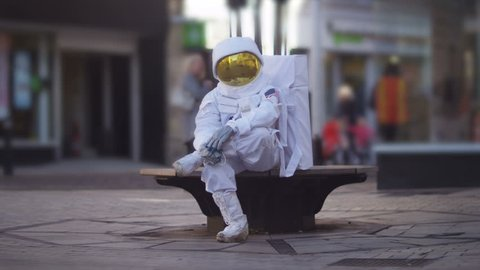 4K Sad astronaut lost in a city on earth. Shot on RED Epic. UK - April, 2016