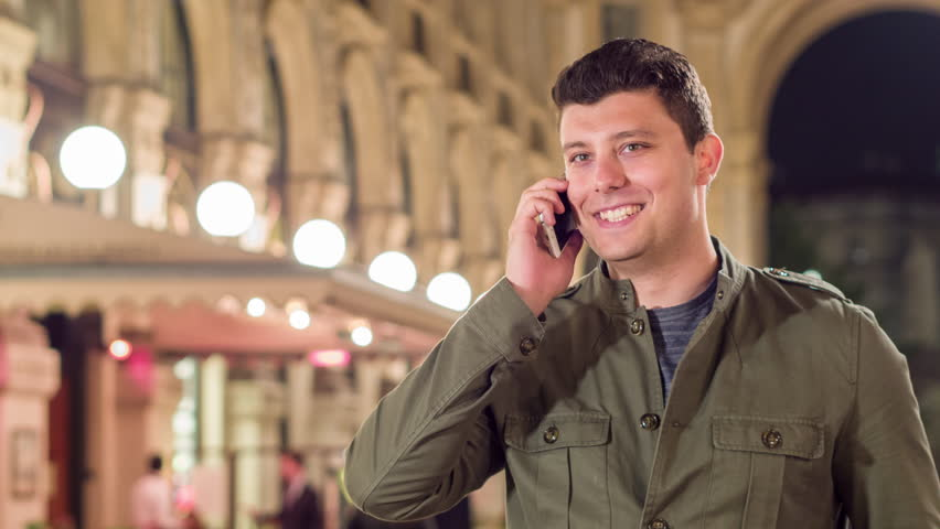 Happy Young Man Walking Through Milan Talking On Cellphone Smiling Vacation In Europe Travel Concept   Shutterstock HD Video #17032888