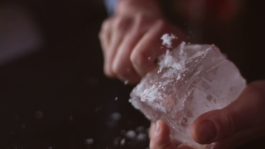 Bartender mannually crushed ice with wooden metal knife. | Shutterstock HD Video #17039848