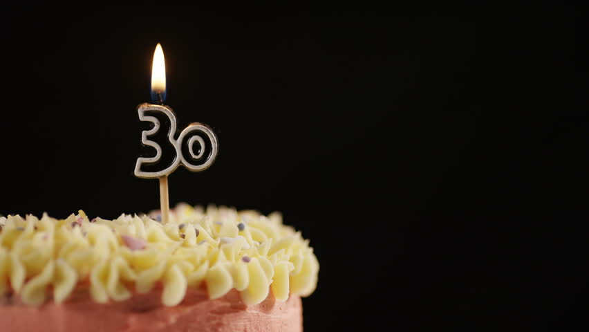 4K Candle For A 30th Celebration Cake Being Blown Out In Slow Motion Space Text