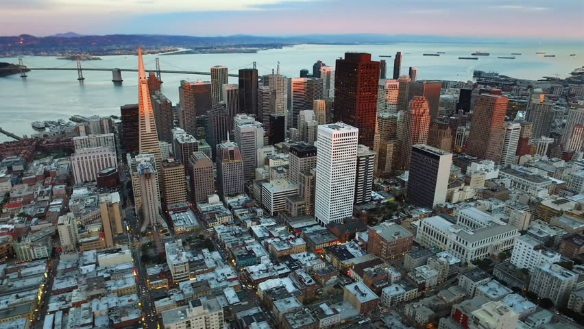 Aerial view of the financial district and the Bay Bridge of San Francisco, California. United States. Skyline. Shot from helicopter.