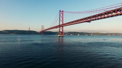 Bridge Ponte 25 de Abril over the Tagus river in Lisbon, Portugal at morning aerial view