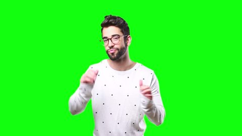 young man dancing on a green screen