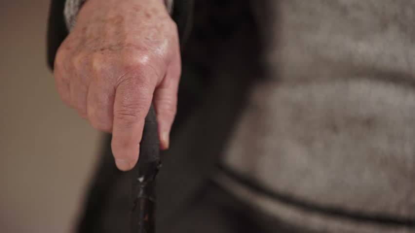 Old man's hand shaking while holding the stick | Shutterstock HD Video #17181928