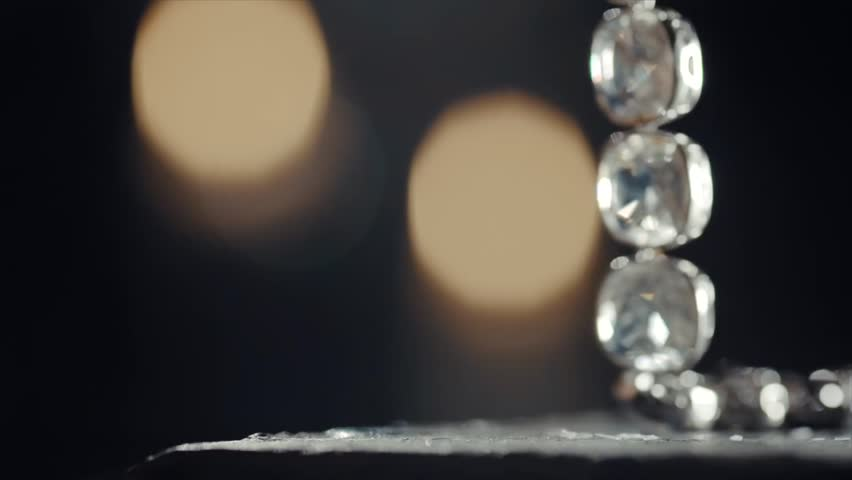 Diamond necklace with large stones falling on the table