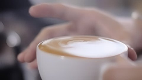 Full Cup of Coffee. Slow Motion Close Up. Close up of a beautiful coffee. Ready to serve. Form slowly moving on top.