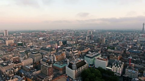 LONDON, UK - JUNE 06: City Centre of London on June 06, 2016 in London, England. 4K Aerial Footage Flying By Over Piccadilly Circus and Leicester Square featuring Regent Street and BT Tower