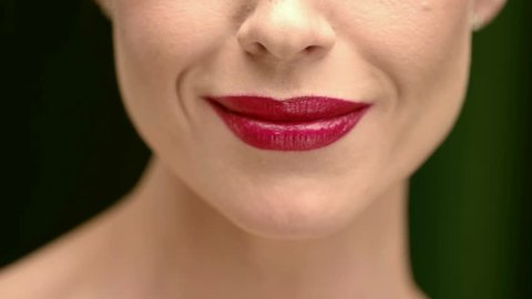 Chocolate Love. Cropped Closeup of a Female Model With Red Lips Eating Chocolate and Smiling Joyfully