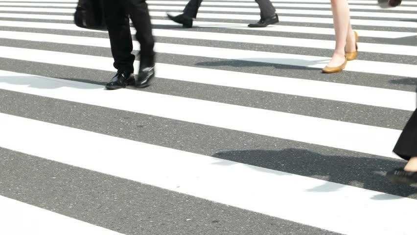 Tokyo - May 2016: People walking on cross walk. Close up of feet. Shinjuku. 4K resolution