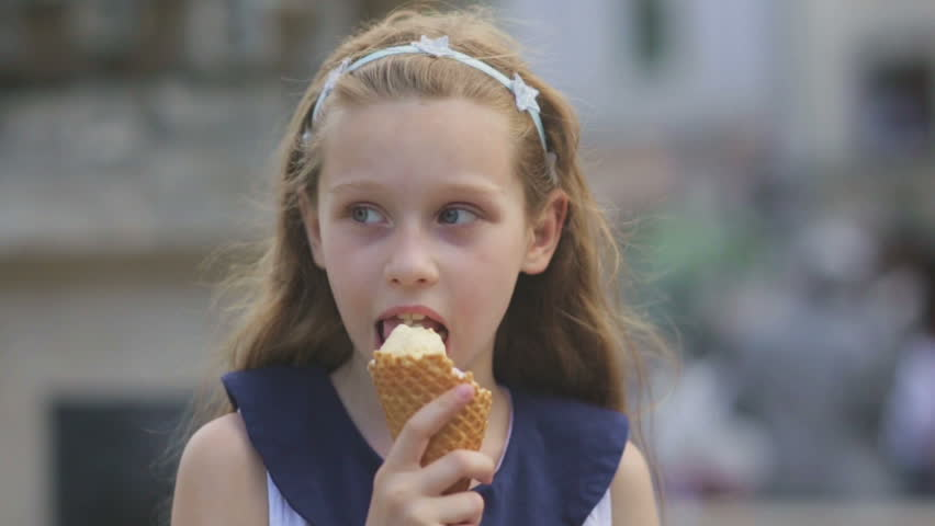 Little Girl Eating Ice Cream Stock Footage Video | Shutterstock