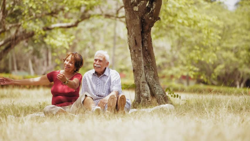 Old people, senior couple, elderly man and woman, husband and wife in park