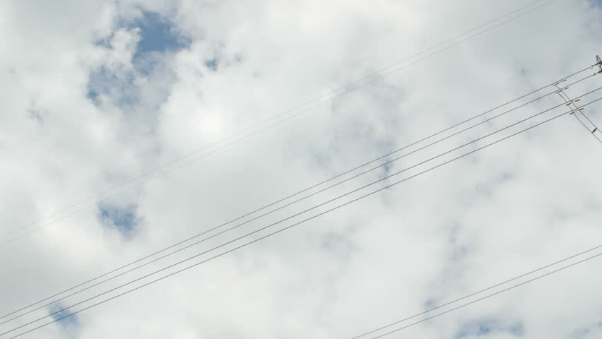 High voltage tower with cloudy sky background. Day low angle shot. | Shutterstock HD Video #17396245