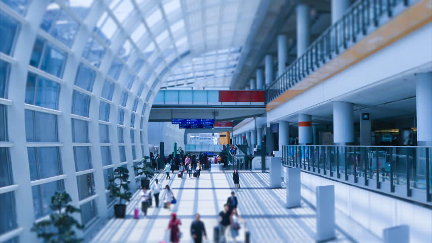 Hong Kong International Airport And People Crowd Walking Time Lapse ( zoom out, miniature , tilt-shift)