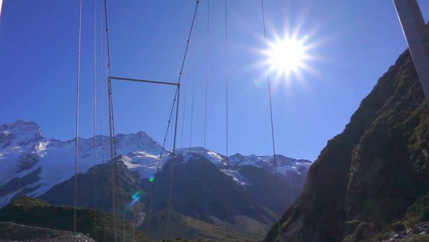 Pan Down View Of Suspension Bridge At Hooker Valley Track, Mount Cook National Park, New Zealand