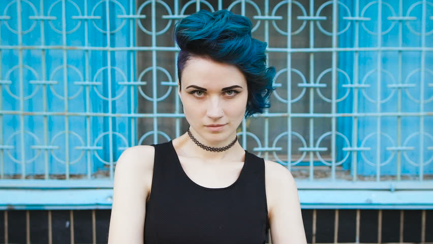 Street punk or hipster girl with blue dyed hair.