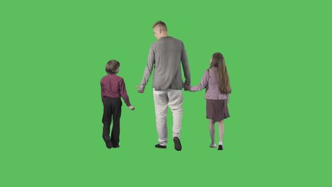 Young father is walking with children from the camera. Camera is static. Lens 85 mm. Footage with alpha channel. File format - .mov, codec PNG+Alpha
