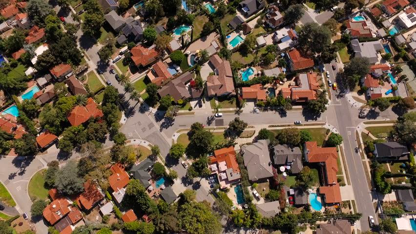 Glendale Aerial v3 Vertical shot flying over neighborhood.