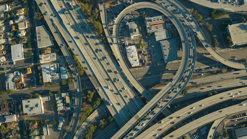 Los Angeles Aerial v132 Vertical shot looking down over downtown freeways panning.