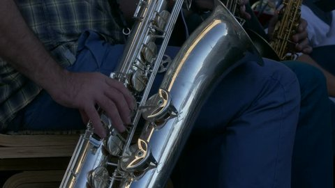 Ungraded: Saxophonist Playing / Sax Player / Orchestra musician. Man playing saxophone in jazz orchestra. Source: Lumix DMC, ungraded H.264 from camera without re-encoding. (av25423u)