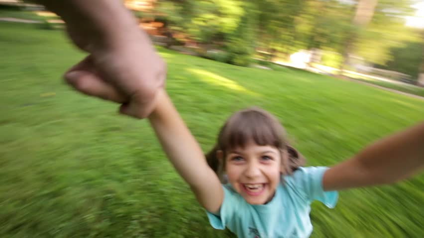 Young girl spinning around in parent's hands, Kid Smiling at Camera | Shutterstock HD Video #17508388