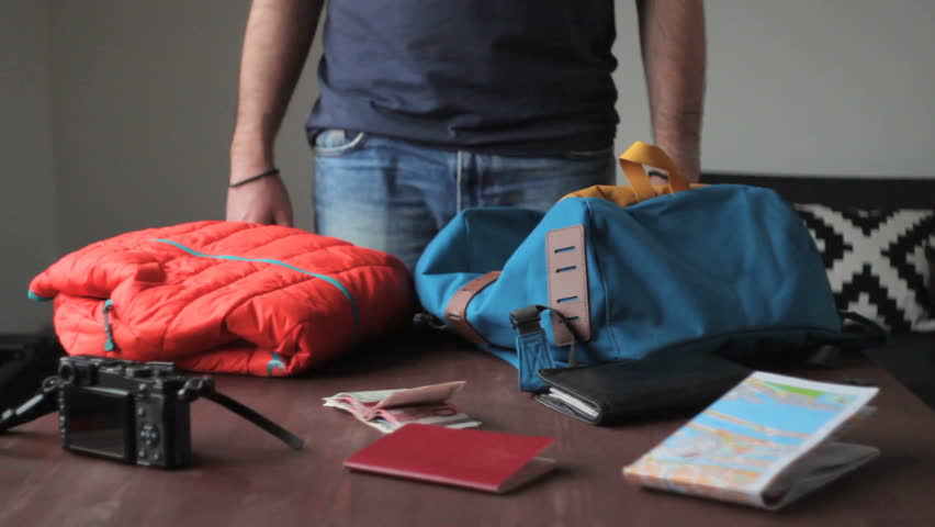 Close up as a hiker packs and prepares his backpack for a hike in the during the day. | Shutterstock HD Video #17531710