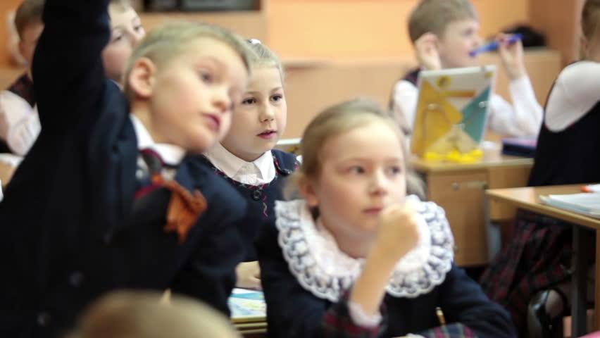 ST. PETERSBURG, RUSSIA - CIRCA MAY, 2016: Schoolchildren listen the teacher while sitting at the desks. Russian elementary school, the lesson   Shutterstock HD Video #17536288