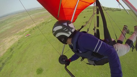 Young girl flies on a hang glider. Video from GoPro onboard camera