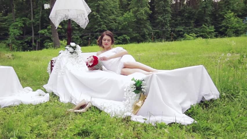 Red Wedding Bouquet In Hands Of The Bride