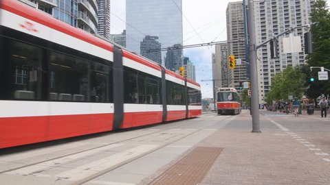 TORONTO, CANADA on June 24th: Old and new streetcars on June 24th, 2016 in Toronto, Canada. The Flexity Outlook by Bombardier at left, has been designed to replace older CLRV streetcars.