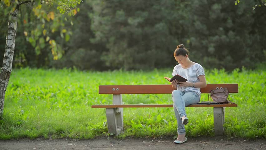 Video Bench Part - 47: Beautiful Woman Sitting On A Bench In The Park And Reading A Book, Student  Preparing
