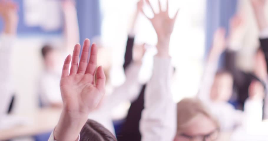 4k, students in class with their arm raised to answer a question. Slow motion. | Shutterstock HD Video #17667802