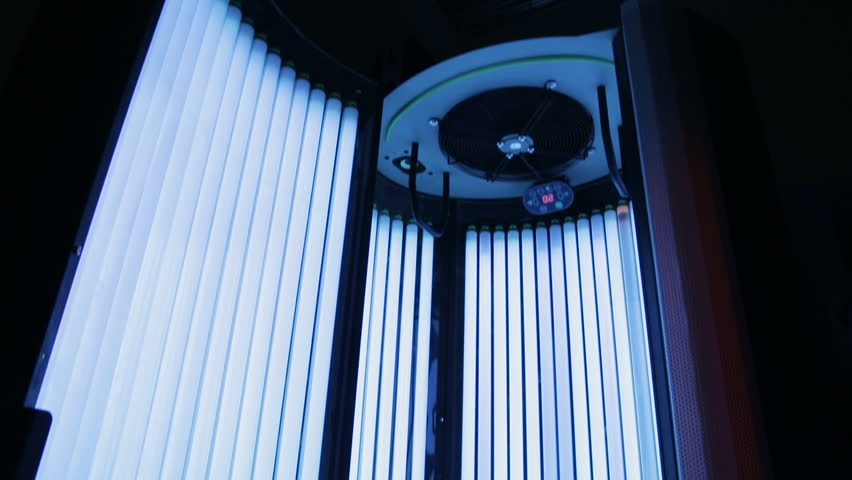 Tanning booths.Spa clinic solarium.Solarium. Stand up tanning system interior showing control panel.Spa treatments, beauty center.