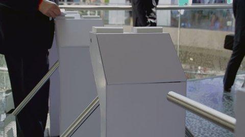 People pass through the turnstile