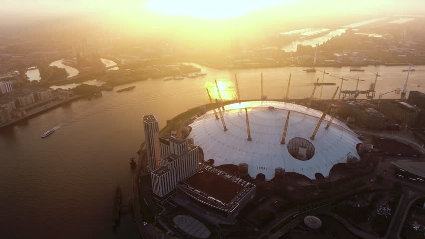 4K Aerial Footage Video Flying by London O2 Arena Concert Hall by the River Thames Waterway at Sunrise Dawn Time Ultra HD - UHD