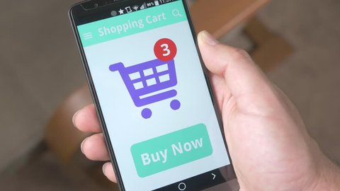 Pressing Buy Now button to buy online with smartphone