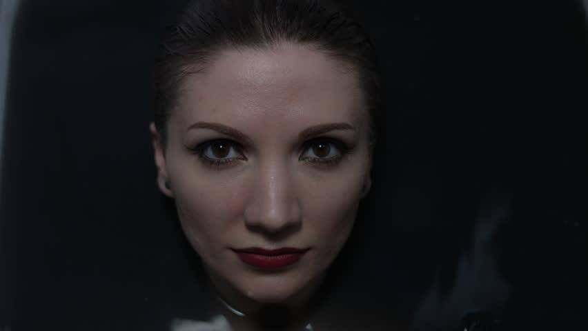 4k shoot of a horror Halloween model - Woman dives in black water | Shutterstock HD Video #17760538